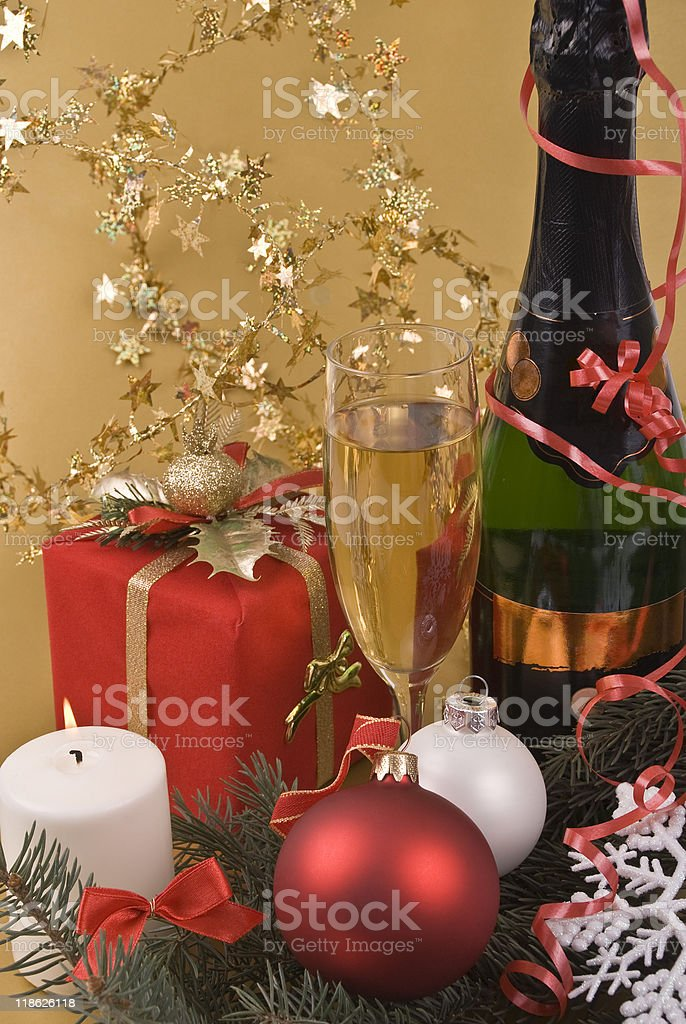 Prize, champagne, candle and New-Year balls royalty-free stock photo
