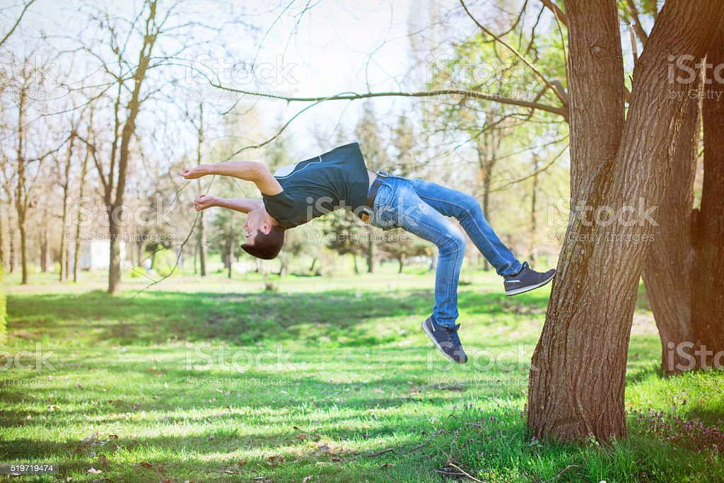 Prkour man jumping high in the park stock photo