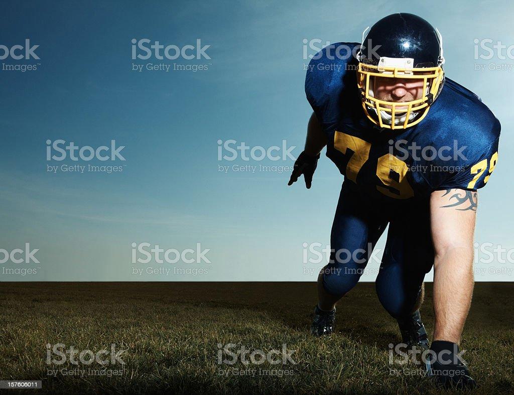 Pro American footballer on field royalty-free stock photo
