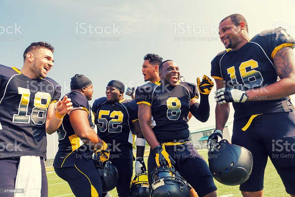 Pro football players celebrating win after playing game royalty-free stock photo