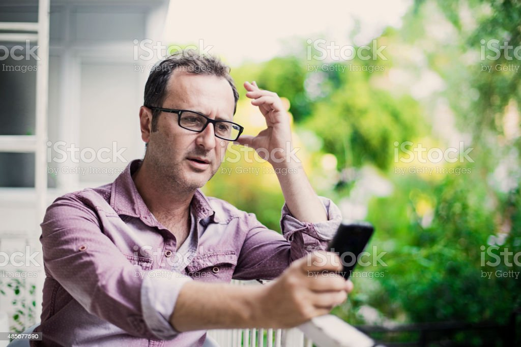 Problem / Bad News. Mobile Phone. Outdoors Adult Man Portrait. stock photo