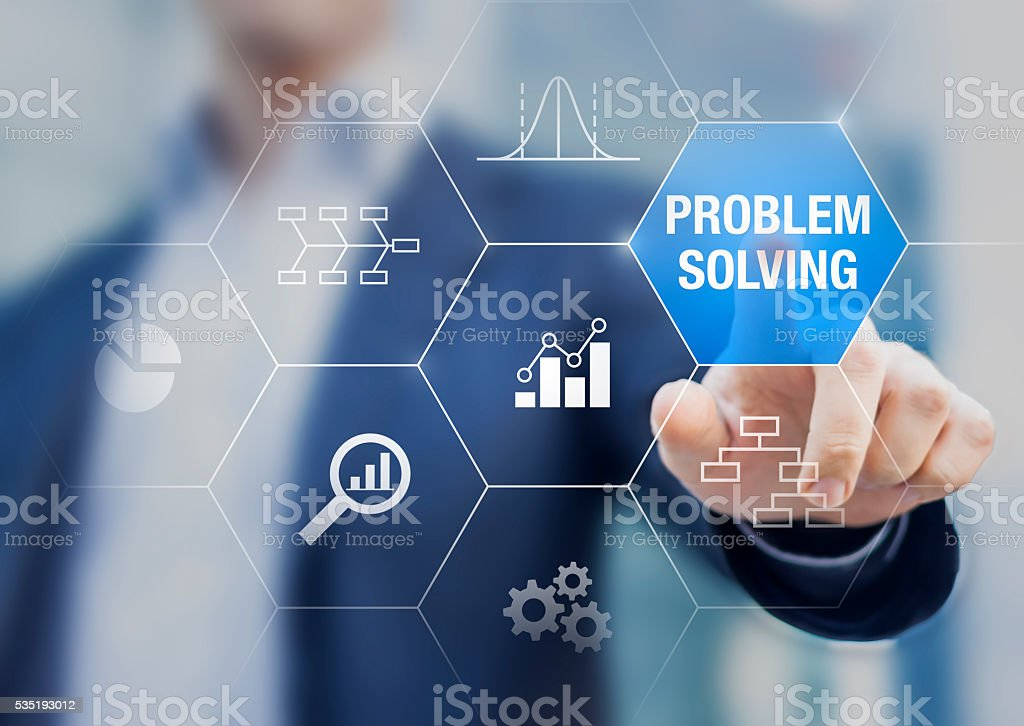 Problem solving concept with diagrams, charts, and businessman in background stock photo