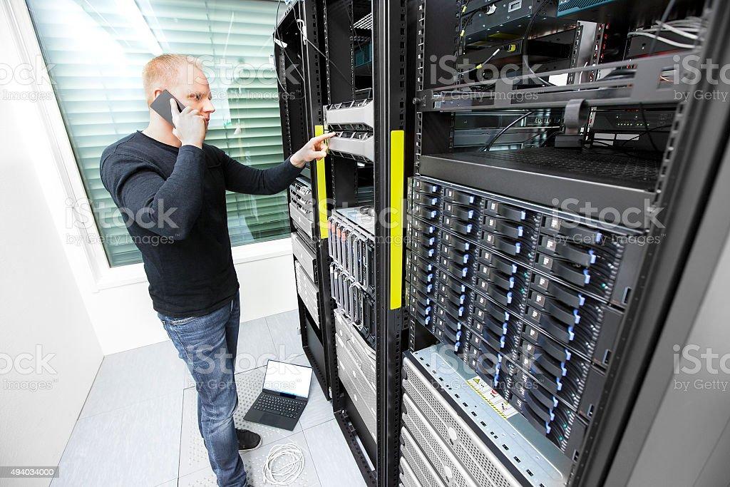 Problem solving IT consultant in datacenter stock photo