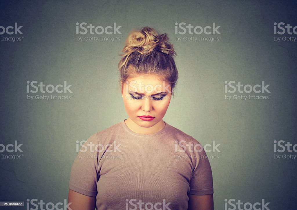 problems. Sad woman looking down stock photo