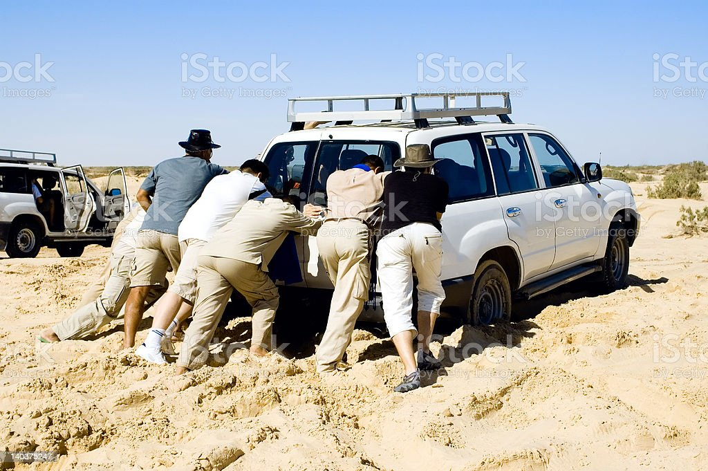 Problems with car while safari at the desert stock photo