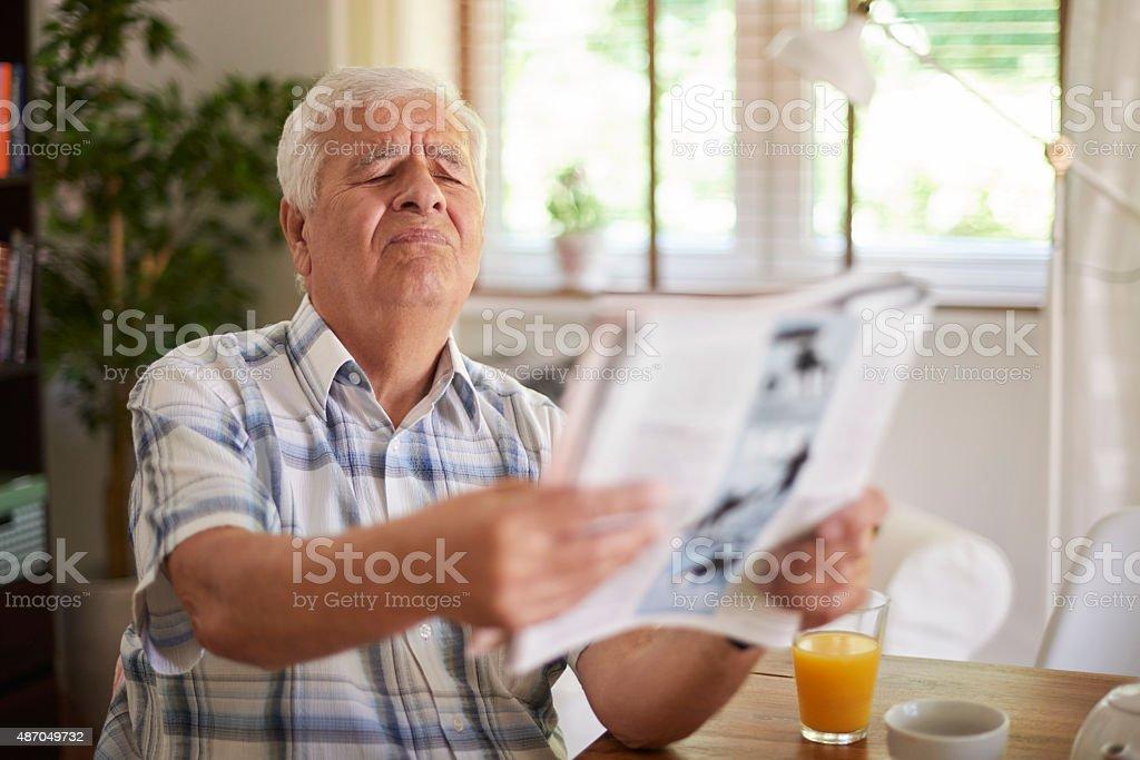 Problems with eyesight of senior man stock photo