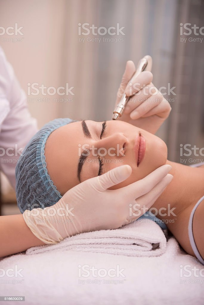 Procedure of professional cosmetology skin care with stock photo
