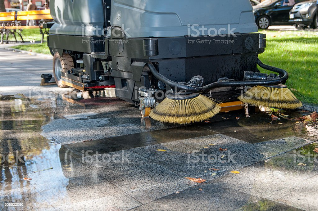 process of cleaning walkways in the machine stock photo