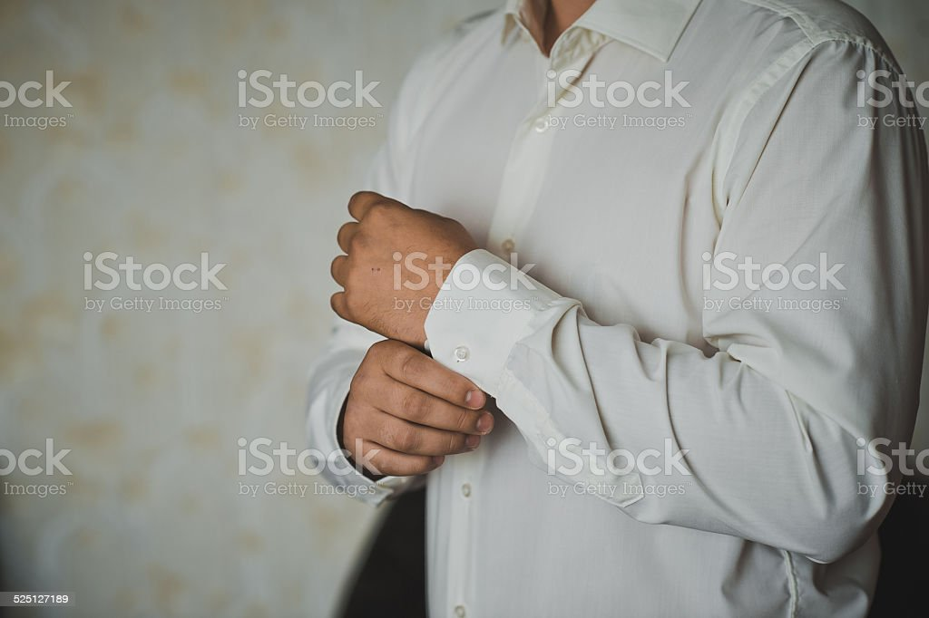 Process of clothing of cuff links 1267. stock photo