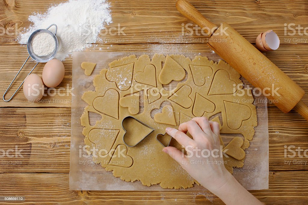 Process of cutting dough for cookie stock photo
