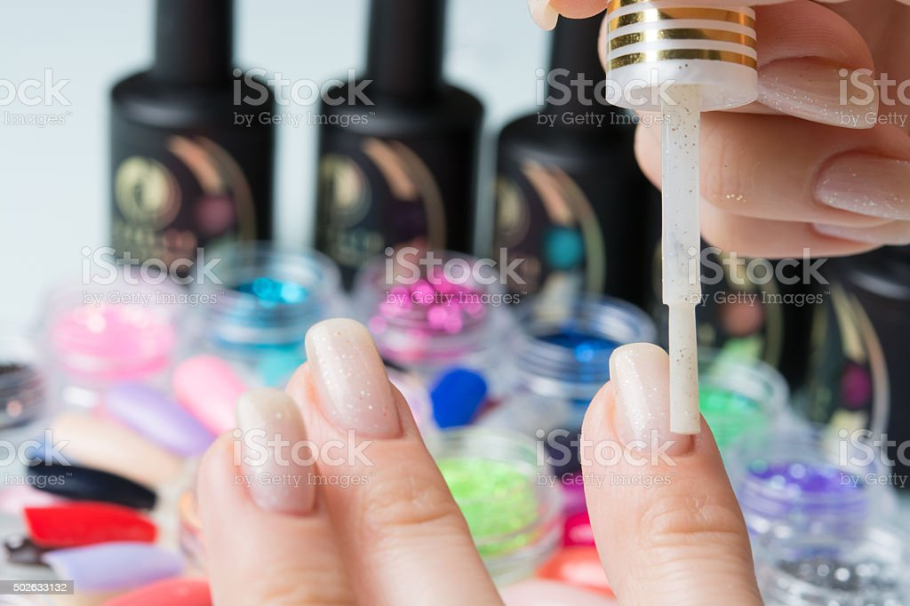 process of lacquer application to the nails stock photo