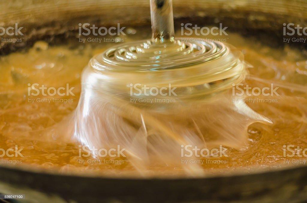 Process of making coconut sugar. Motion Blur. stock photo