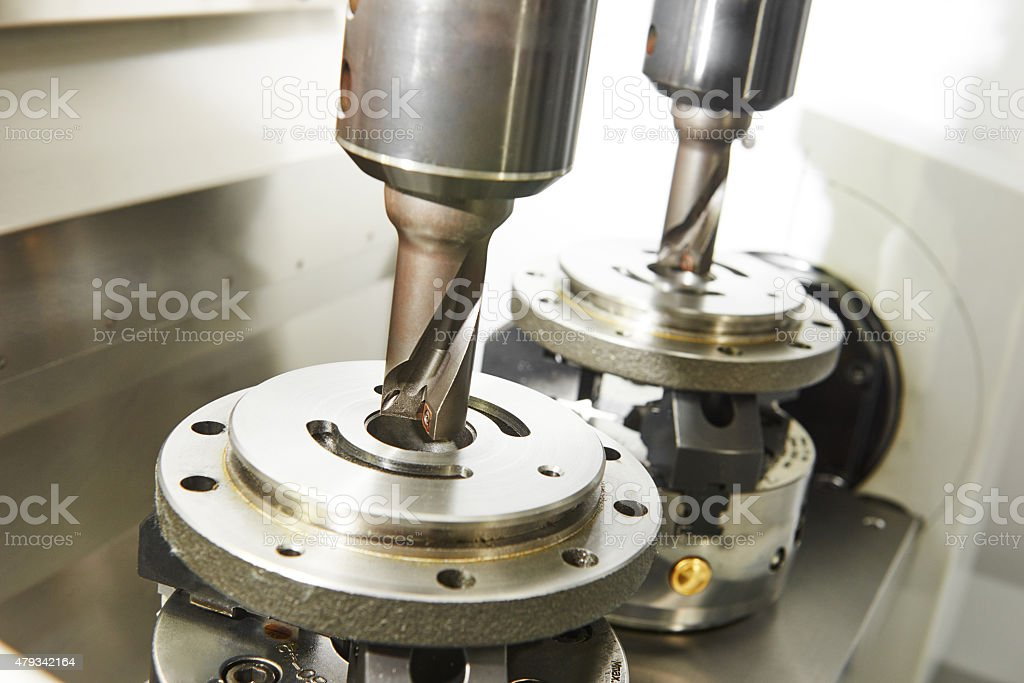 process of metal machining by twin mill stock photo