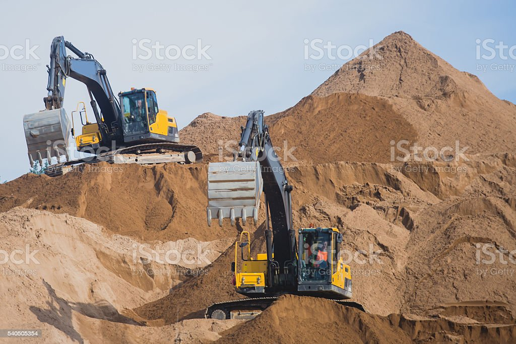 Process of new road construction, bulldozer and excavator at work stock photo