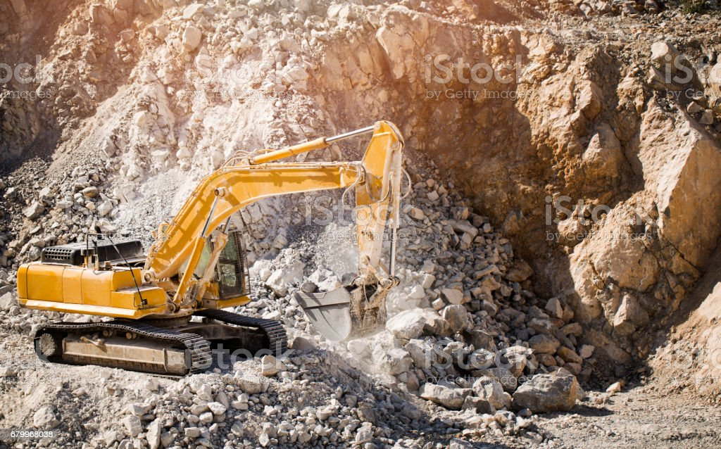 Process of new road construction, bulldozer and excavator at work