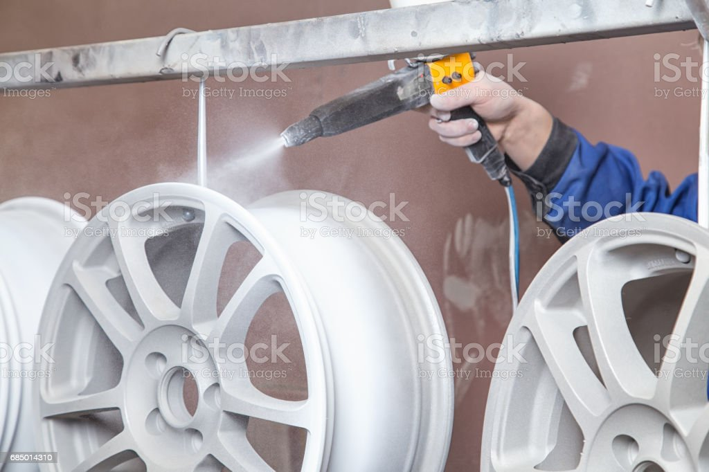 Process of powder coating auto disks stock photo