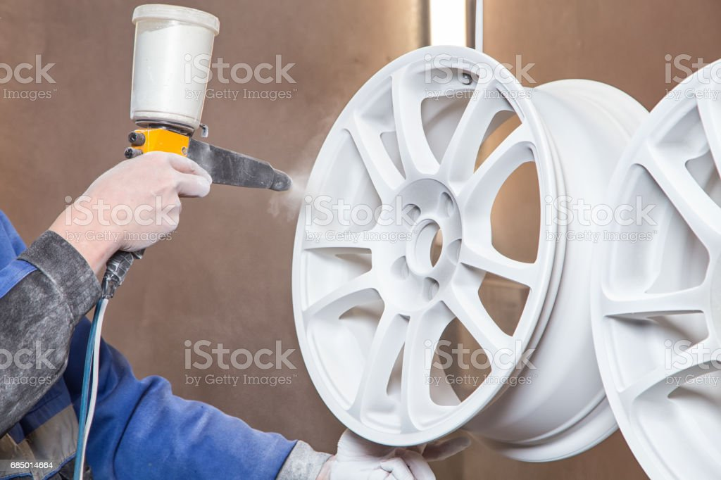 Process of powder painting auto wheels stock photo