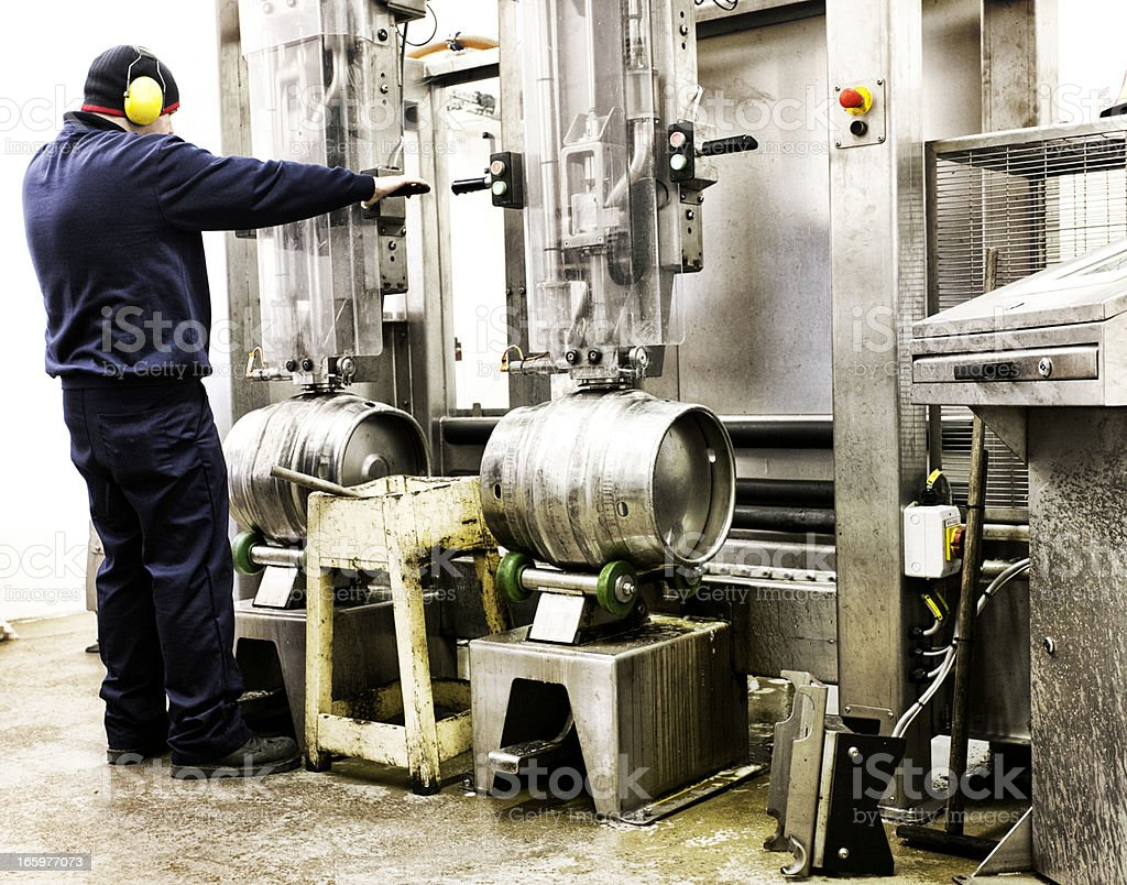 Processing empty beer kegs royalty-free stock photo