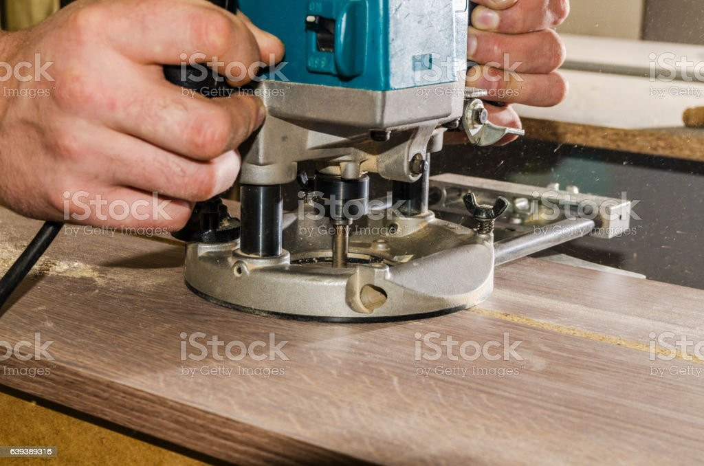 Processing furniture part edge stock photo