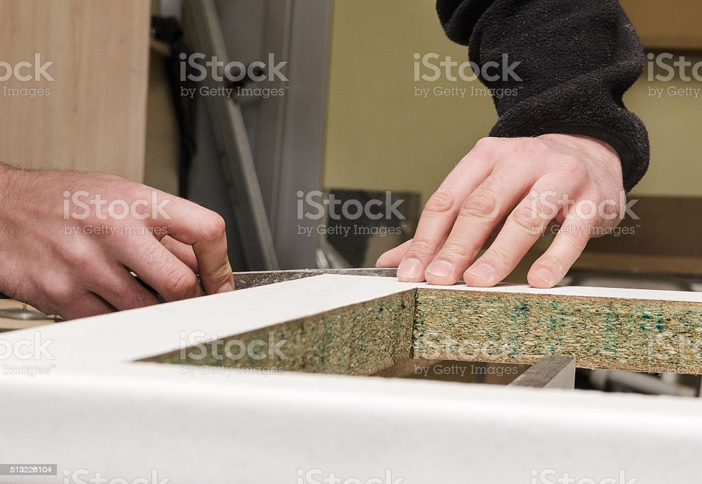 Processing kitchen countertop before installing stock photo