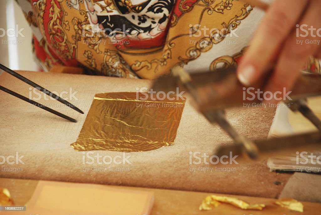 Processing of gold leaf royalty-free stock photo