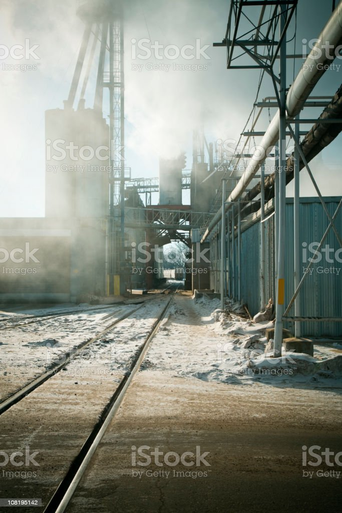 Processing Plant with Railroad Tracks During Winter stock photo