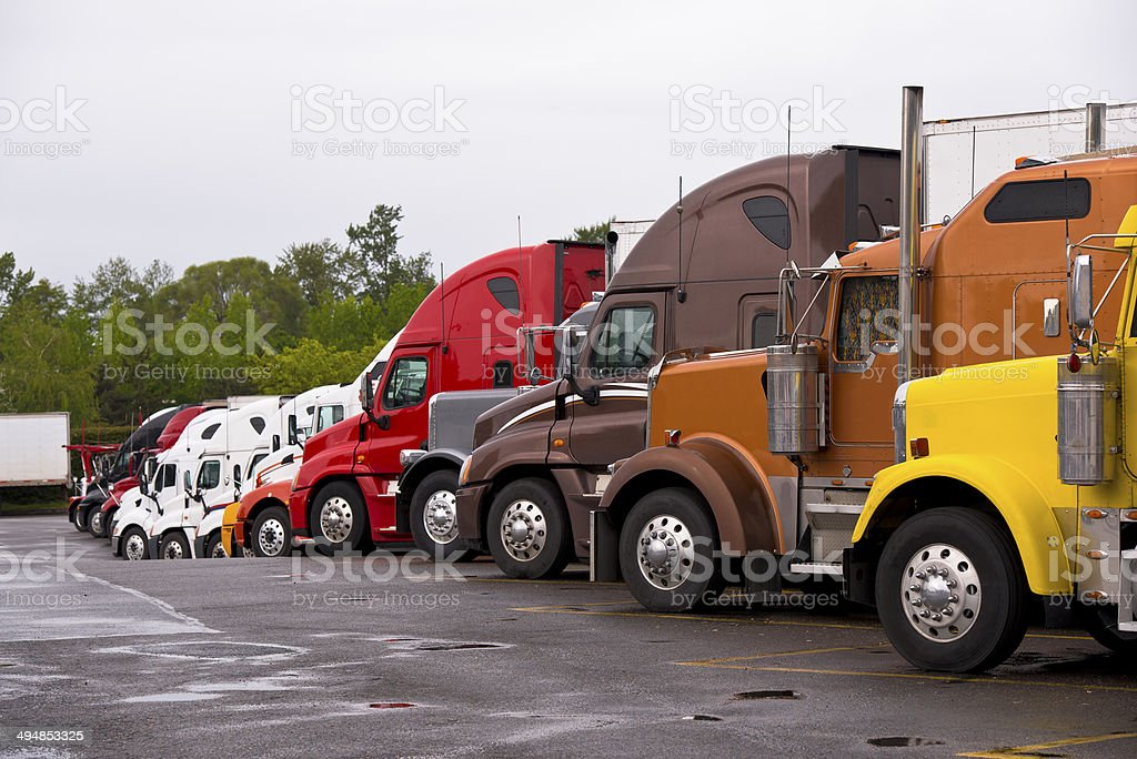Procession colorful trucks on the truck stop after the rain stock photo