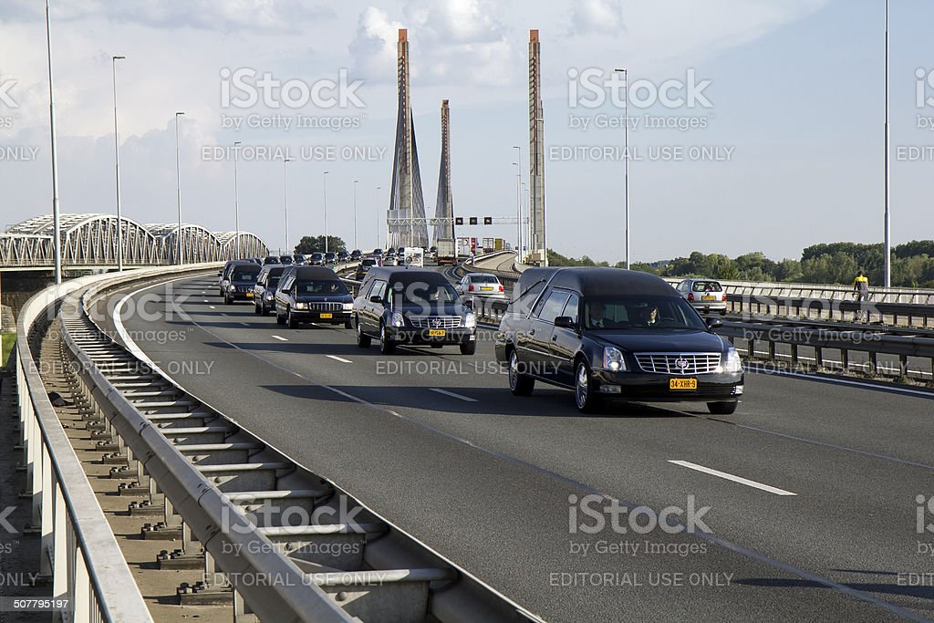 Procession of hearses carrying victims of the MH17 crash Ukraine. stock photo