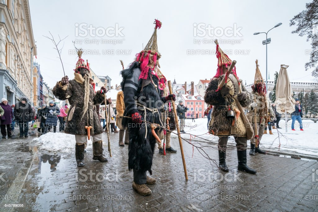 Procession of masked groups stock photo