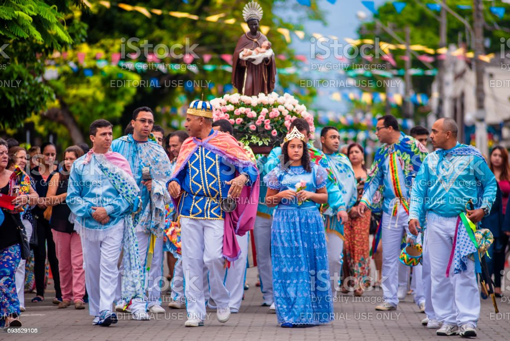 Procession of St. Benedict walking the streets of the center of the city of Ilhabela, Brazil. The event is part of the Feast of St. Benedict, traditional for more than two hundred years. The saint is led by the devotees who participate in the Congada. stock photo