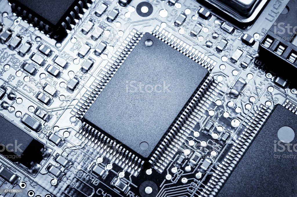 Processor board. Macro photo. Blue toned royalty-free stock photo