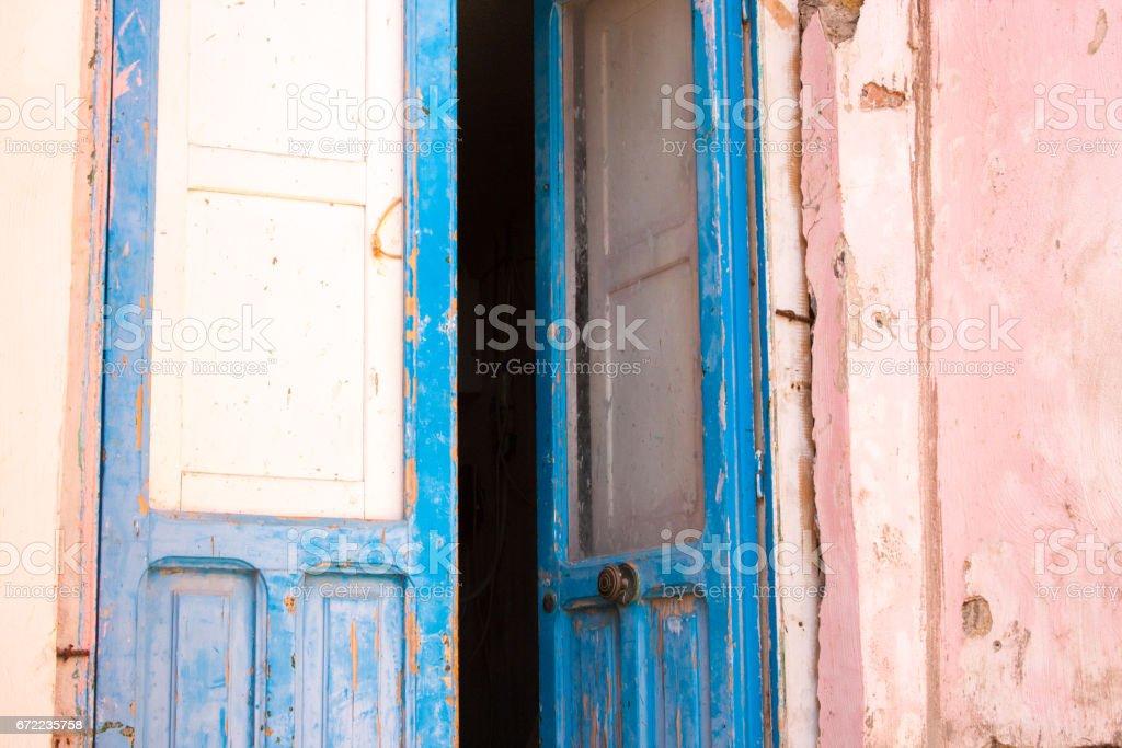 Procida (Naples), Italy: Old Blue Door, Pastel Pink Wall stock photo