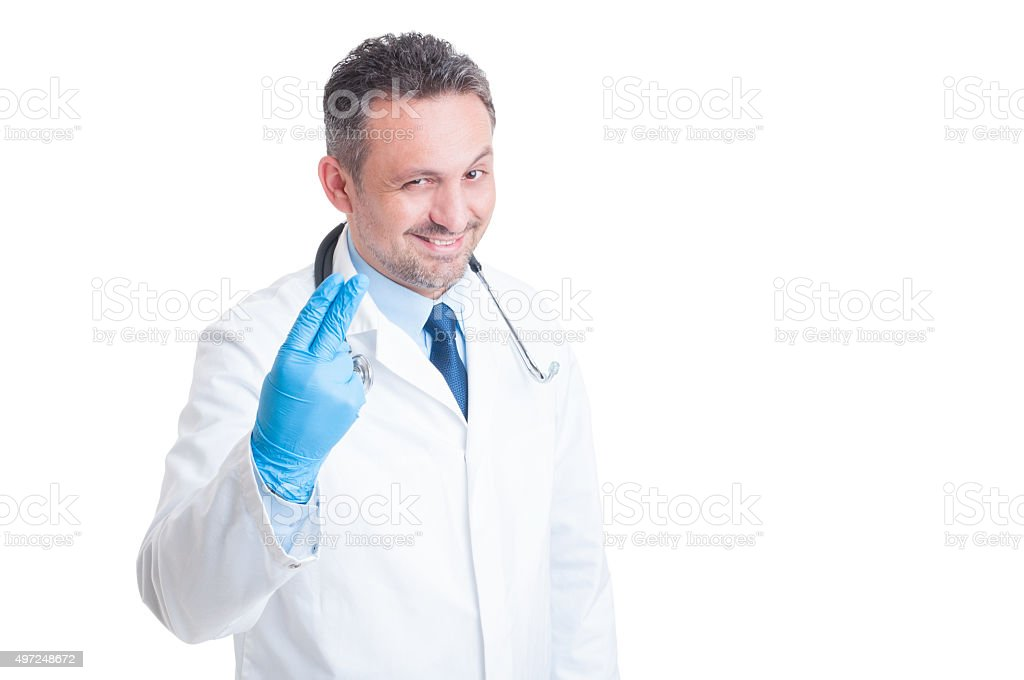Proctologist showing two fingers with surgical latex gloves stock photo