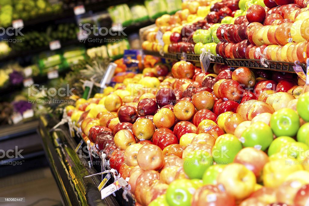 Produce aisle with apples at the grocery store royalty-free stock photo