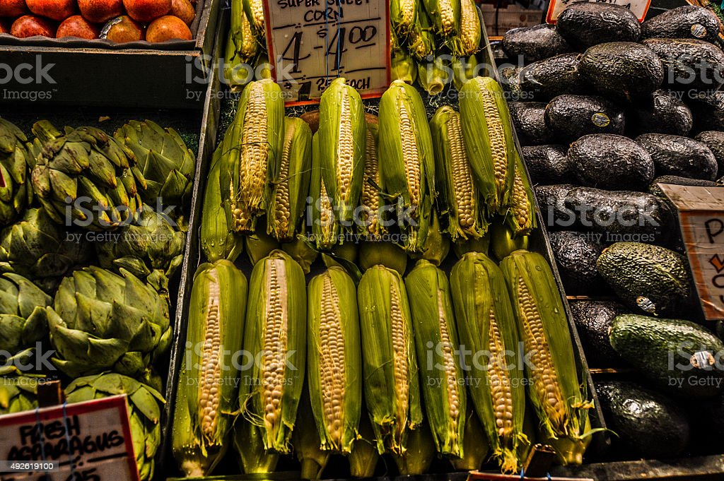 Produce market - corn, avacado, and artichoke stock photo