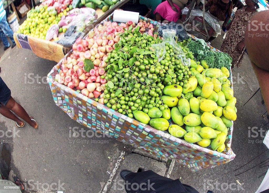 produce market stall and fresh fruits for sale stock photo