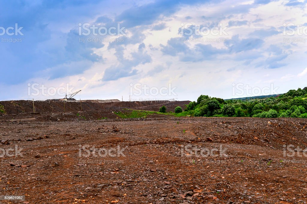 Production area with road and rocks stock photo