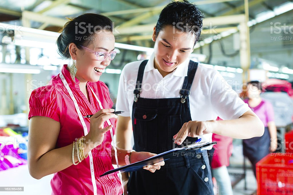 Production manager and designer in a factory royalty-free stock photo