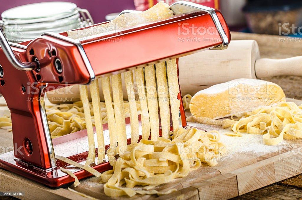 Production of homemade pasta - Italian pasta grinder stock photo