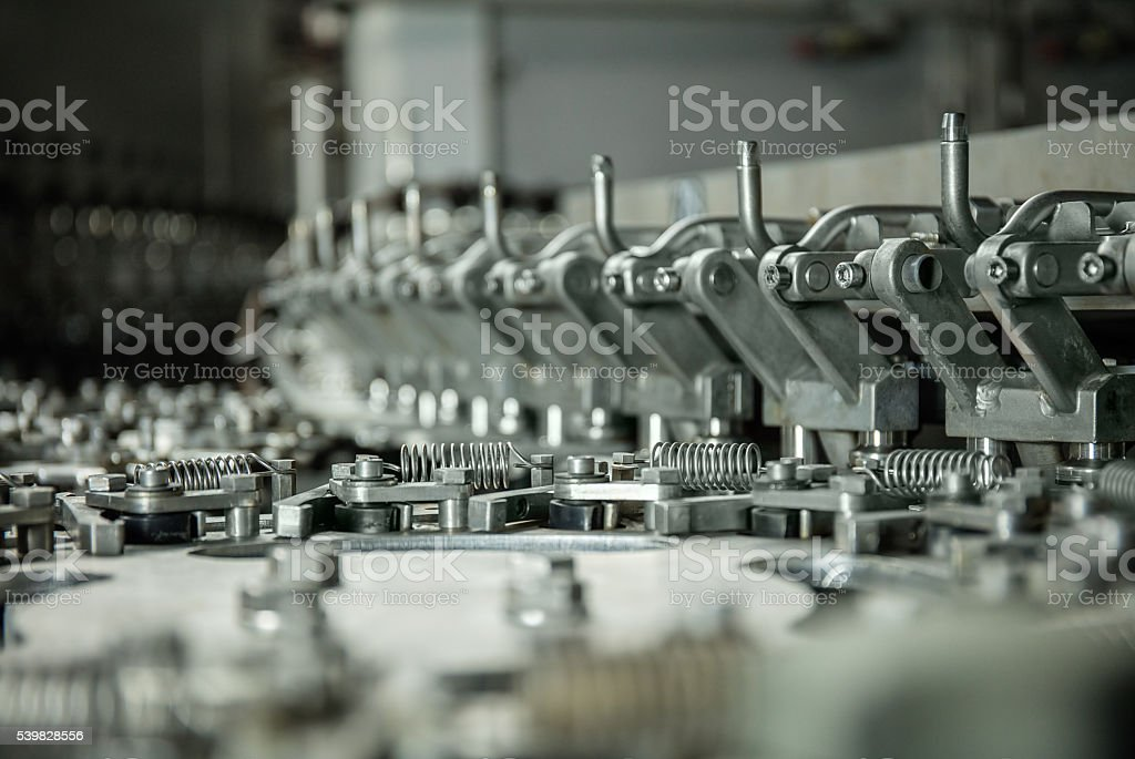 production of plastic bottles of mineral water lemonade. stock photo