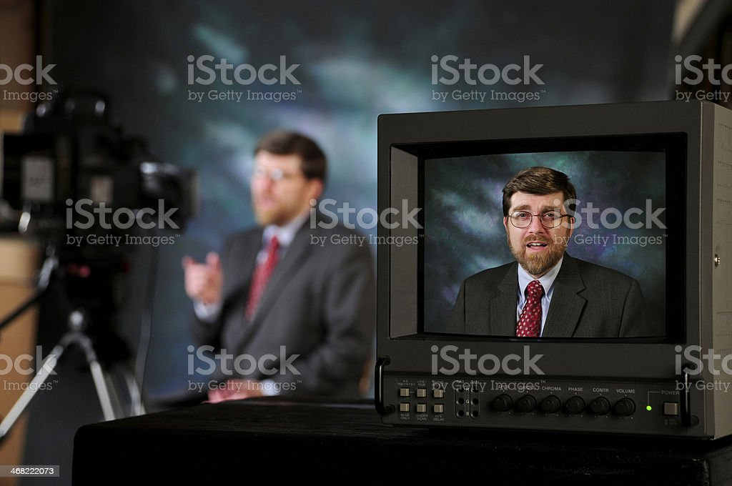 TV production studio showing man talking to camera stock photo