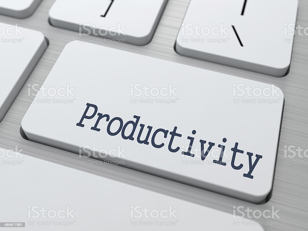 Productivity on Button of White Keyboard. stock photo