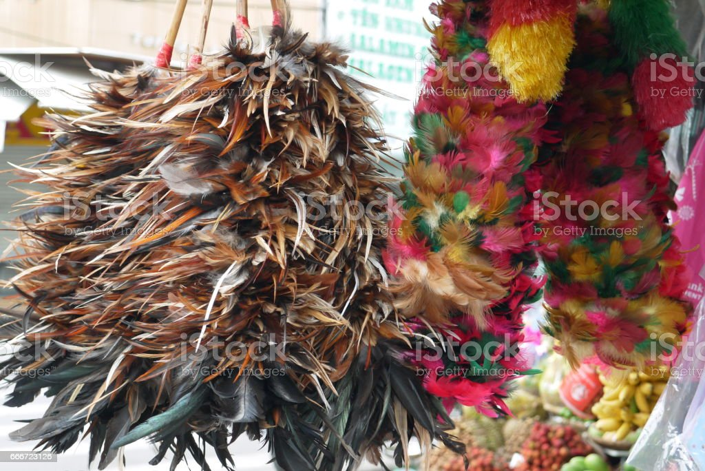 Products from multi-colored feathers stock photo
