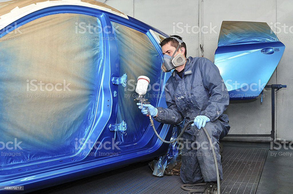Profesional car painter. stock photo