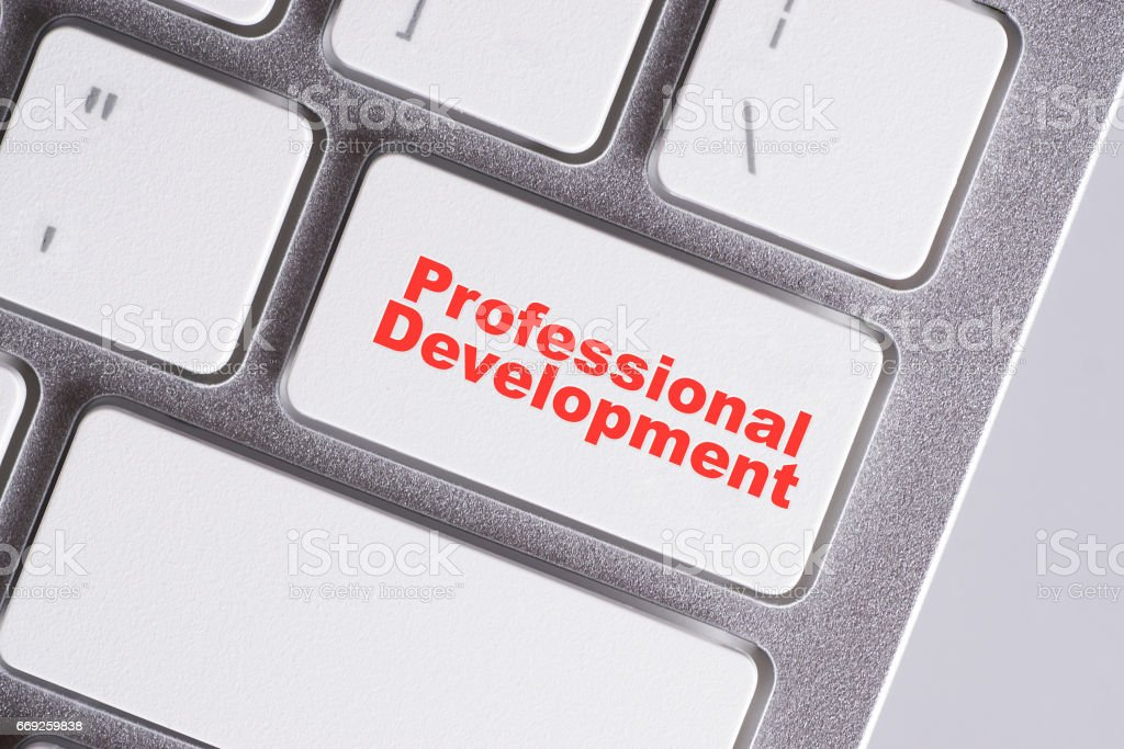 'Profesional development' red words on white keyboard - online, education and business concept stock photo