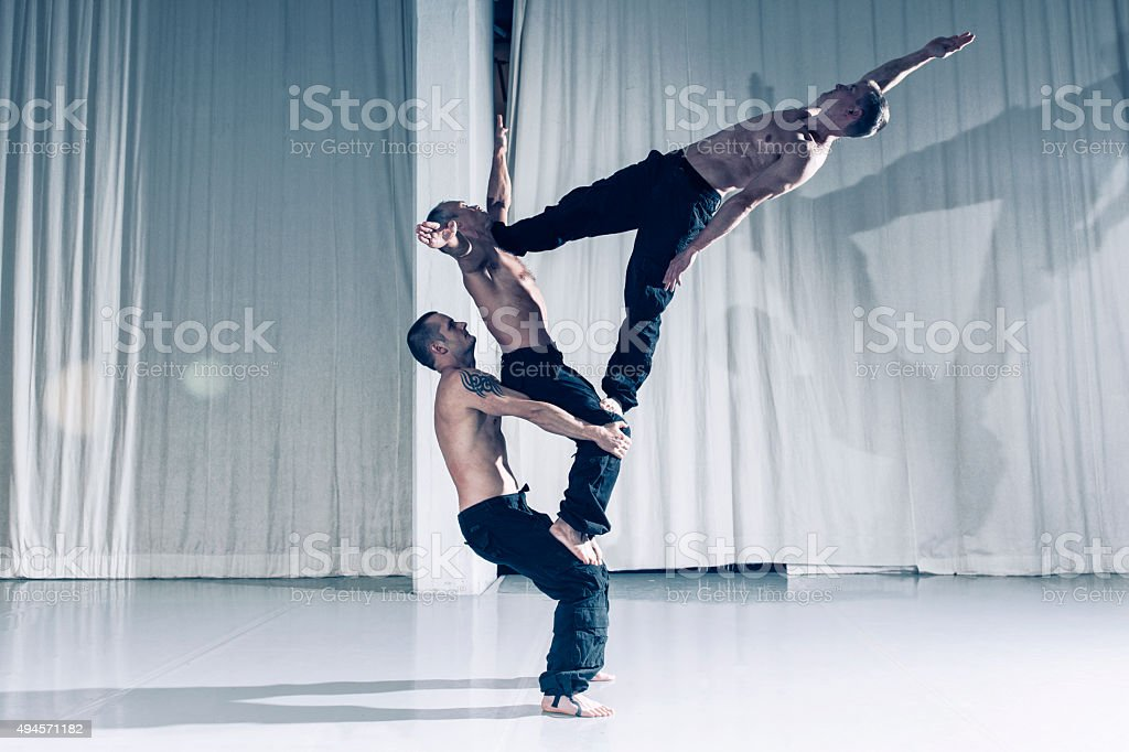 Professional acrobats performs as a team stock photo