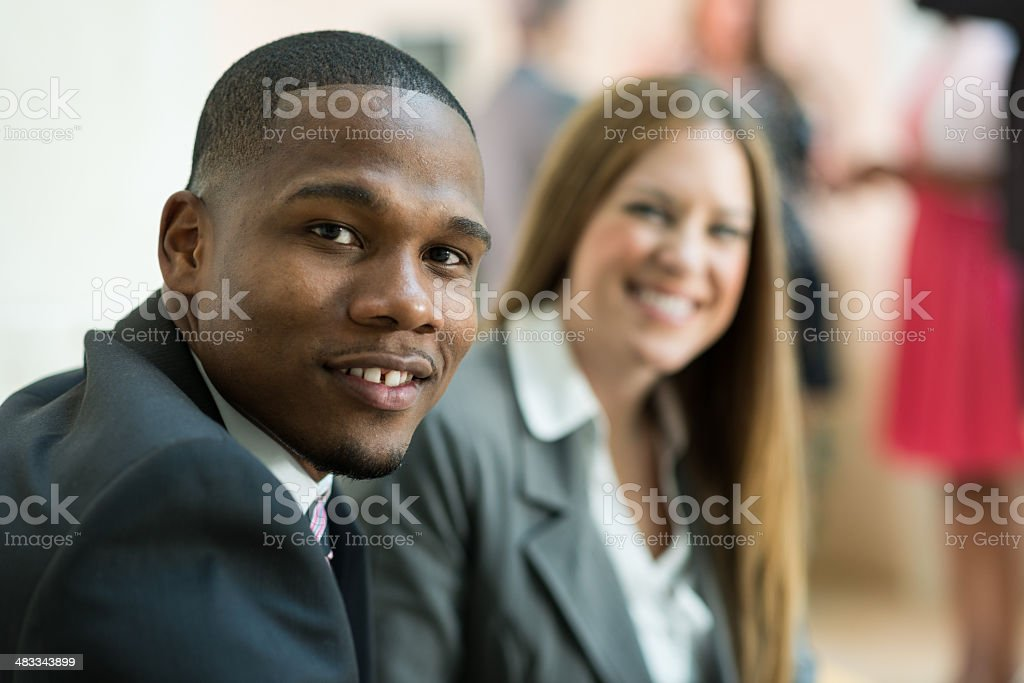 Professional African American Businessman Smiling During Business Meeting stock photo