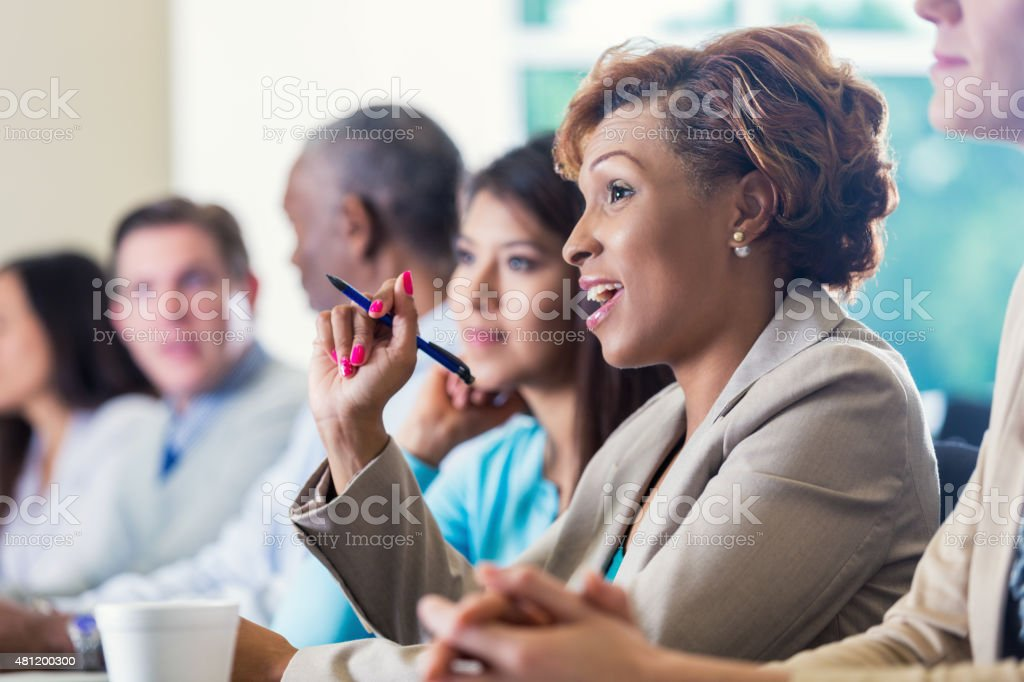 Professional African American businesswoman asking question during business conference stock photo