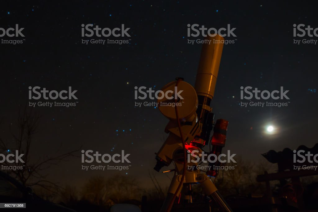 Professional astrophotography equipment working under the dark sky. stock photo