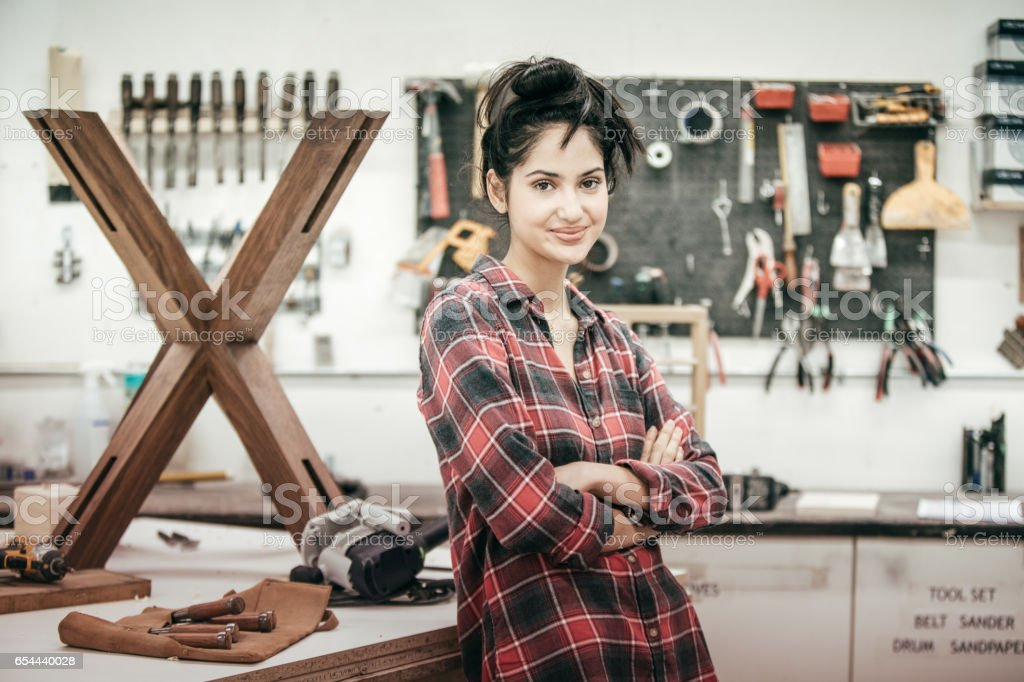 Professional at woodworking studio stock photo